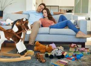 Couple in cluttered living room