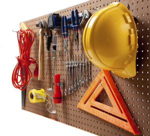 Peg board with tools and hard hat