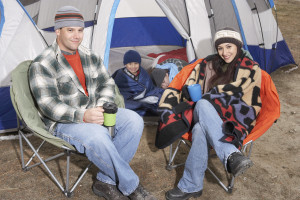 Happy Family Of Four Camping Together