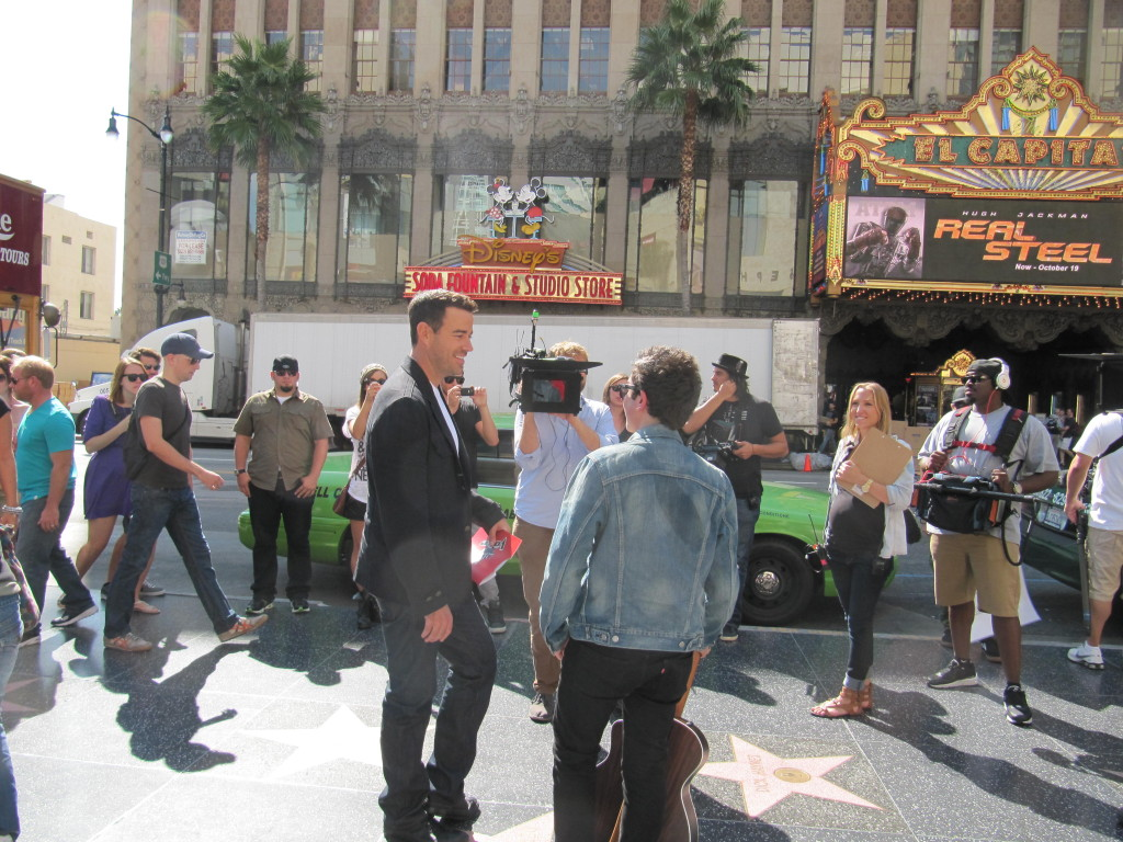 Carson Daly Interviews Street Musician at Hollywood & Highland